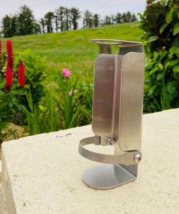 Outdoor anti-theft hand sanitizer dispenser bracket supplied by Doody Engineering